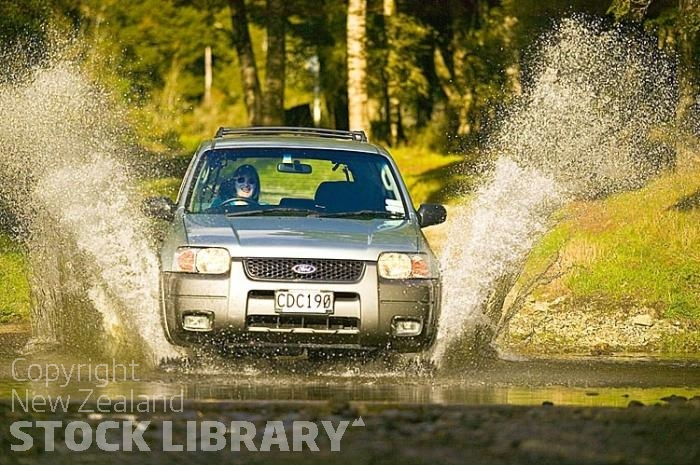 4x4 fording creek;Buller Region;Bush;creek;Buller Region;flowing water;stream;splashing;ford car;laughing driver